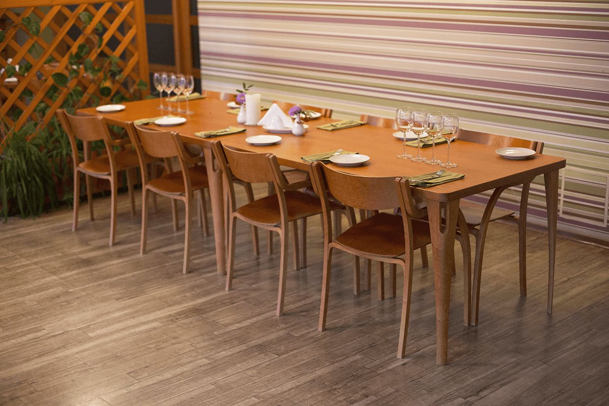 Durable wooden table from the birch, stained cherry