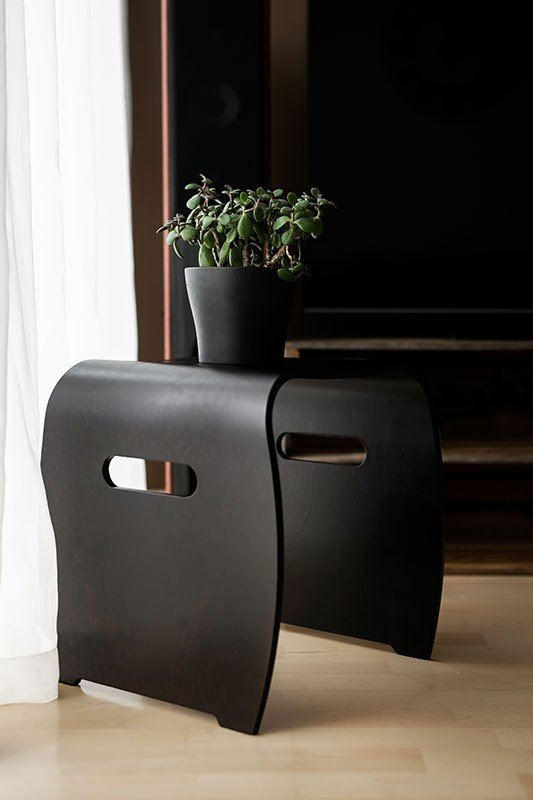 Contemporary plywood stool from the birch, stained black